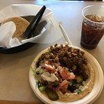 Shawarma with salad, humus and pita.