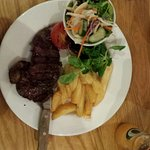 Steak and chips with salad