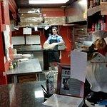 Alex stretching the dough