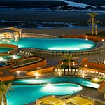Pools/beach at night time.