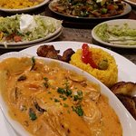 Grilled chicken breast with brandy/lobster bisque sauce. yellow rice & fried plantains