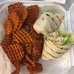 Grilled ceasar wrap and sweet potato fries to go. Wrap was fresh,fries were hot and crispy.  Ope