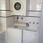 Laundry in bathroom - studio unit