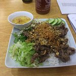 Fried beef with rice noodles and salad.