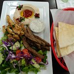 Combo chicken shawarma and gyro plate with salad and humus.