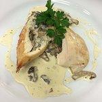 Chicken breast stuffed with wild mushroom, with a cream of wild mushroom sauce