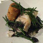 Cod and squid ink risotto with king prawn croquette. Delicious