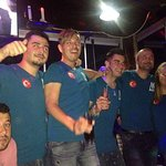 Staff and guests wearing Musti's t-shirts and enjoying the evening. We love Celo + Ahmet!