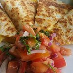 Breakfast quesadillas served with sour cream, fresh guacamole and pico de gallo.