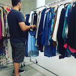 Helping his wife choose from the fab designer pieces.