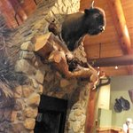 A stuffed bison head above a huge fireplace