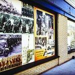 Historical murals adorn windows along Wyandotte near Gladstone