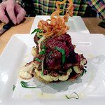 Beef short ribs with roasted cauliflower on a polenta cake