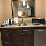 Mini Fridge, Microwave, Kreuig, a few kitchen items. Closet/long mirror. Very Clean