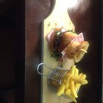 home-made beef burger served with chips, onion rings and relish