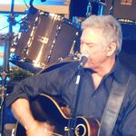 close-up of Larry Gatlin singing