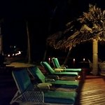 Main deck at night - plenty of chairs and loungers at each room and around the ersort