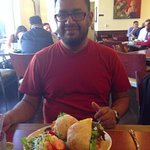 Happy customer contemplates salad and huge sandwich!