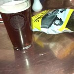 "A nice pint of ""Windrush"" ale and a bag of Tyrells!"