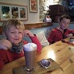 The boys enjoying their hot chocolate and Mary's pumpkin buns!