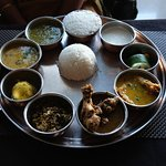 This Thali includes Assamese style fish curry, chicken curry, veg, daal, rice, sweet and pickles