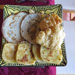 international breakfast treats: fresh Brittany crepes, deep fried pastry and Moroccan milawi [lo