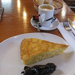 A chunky slice of tortilla with morcilla and a cafe cortado.