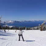 Skiing/Snowboarding on Heavenly with beautiful views of the lake.
