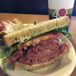 Hot corned beef piled hgh on rye bread.