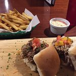Duck slider, pork slider, fries cooked in duck fat, and lime jalapeño aioli. Crazy good.