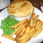 Home­Made Steak and Ale Pie with hand cut chips, seasonal vegetables