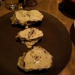 Baked Pacific oysters with whipped garlic butter, truffle
