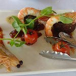 """""""Surf n' Turf"""" spiced rubbed Angus beef rump with tiger prawn and black garlic butter"""