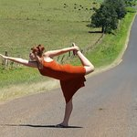 yoga is always a good pose at the farm the cows just mooed