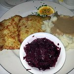 breaded pork tenderloin with mashed potatoes and red cabbage