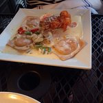 Lobster Ravioli w/ petite lobster brandy cream sauce
