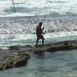 A local fisherman on the beach at the back of the hotel