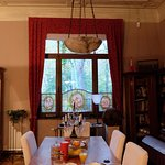 Beautifully set breakfast in the main dining room, views of the park of Basilica of the Sacred H