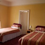 Room 4  adjoining twin, twin with private bathroom (no ensuite)