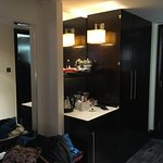Wardrobe (with safe), mini bar and beverage set-up, mirror and tv.