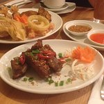 ribs and mixed starters with chili and peanut dip