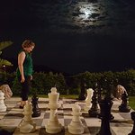 Outdoor chess at night overlooking the Mediterranean