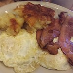 Easy over eggs with potatoes and bacon