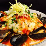 Mussels, prawns, pacific cod, leek tomato sauce, fresh made linguine, reggiano cheese