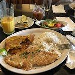 Had the filete de pescado (fish filet) and an empanada and jugo de maracuya (passion fruit). It