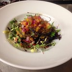 Black pudding fritters on a bed of dressed leaves, with a pineapple chilli salsa.