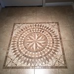 Pretty tile work in the room's entrance foyer