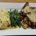 Pork steak accompanied by mustard mash with apple garlic and shallots
