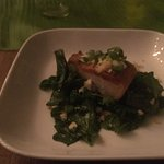 Butter fish on local greens