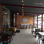 Covered outdoor seating - eating area at Redbud Cafe in Blanco.
